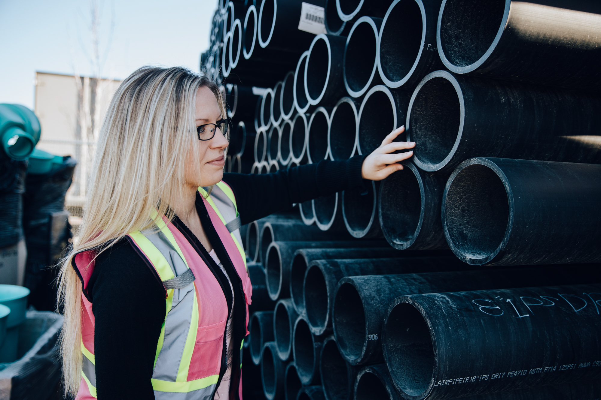 ICONIX-employee-in-yard-HDPE-pipe